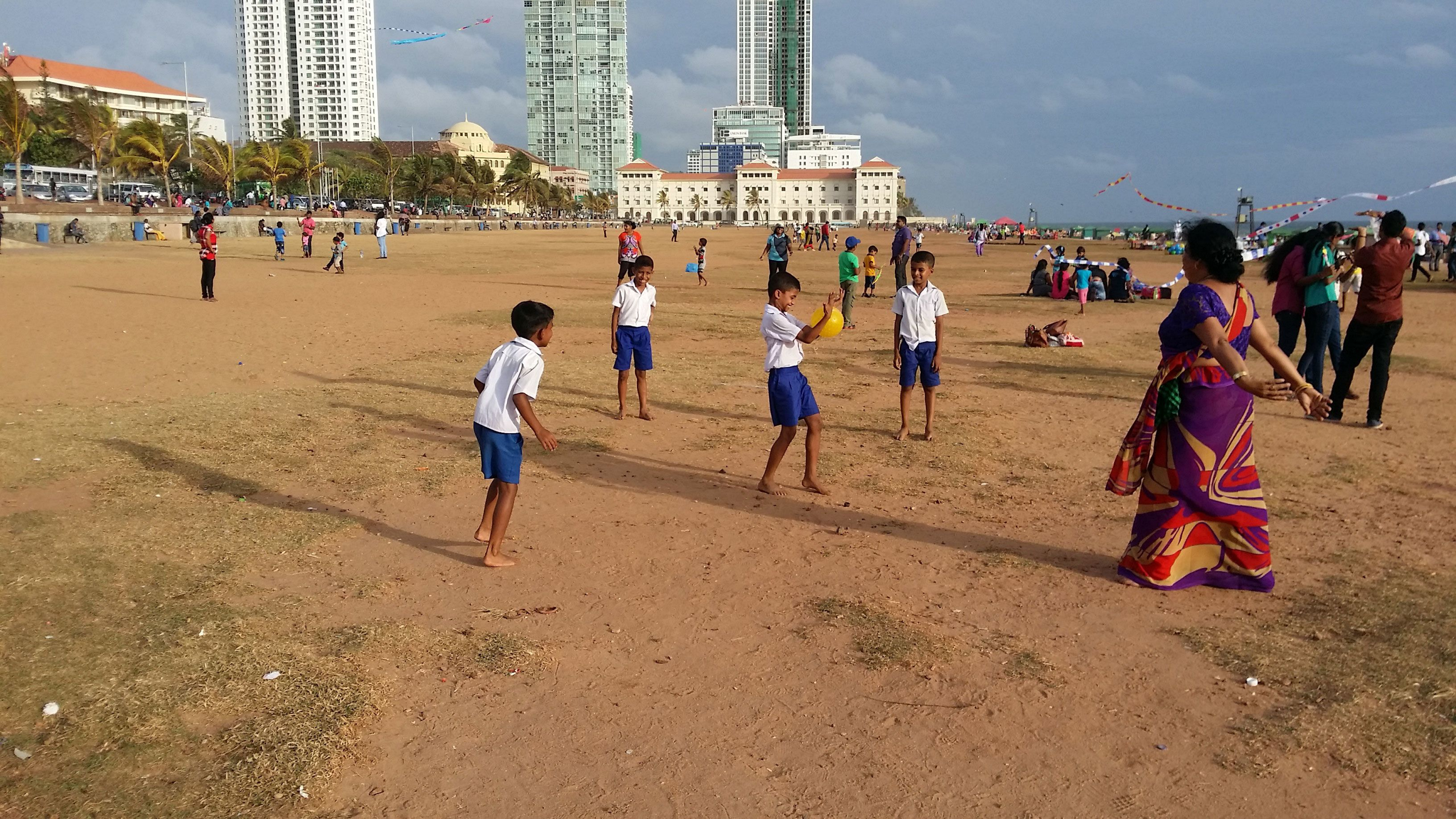 People on the beach near the city in Colombo