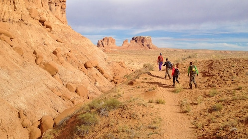 group hiking around a rocky mountain in Utah