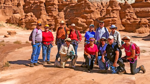 climbers huddling near a rock formation in Utah