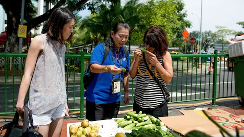 Women with tour guide at a street market in Singapore