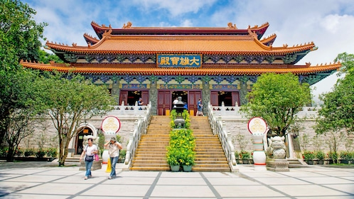 at the steps of a temple in Hong Kong