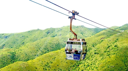 taking a gondola up the mountain in Lantau Island
