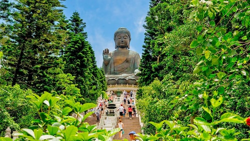 a large Buddhist statue at the top of the climb in Lantau Island