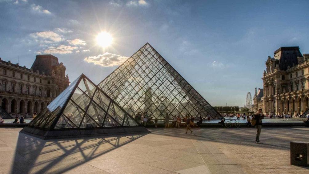 Cargar ítem 3 de 9. glass pyramid of the Louvre basking in the daylight in Paris
