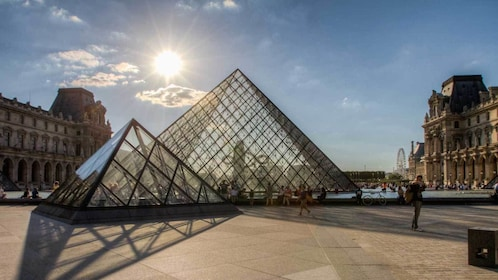 glass pyramid of the Louvre basking in the daylight in Paris