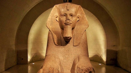 sculpture of an Egyptian sphynx at the Louvre in Paris