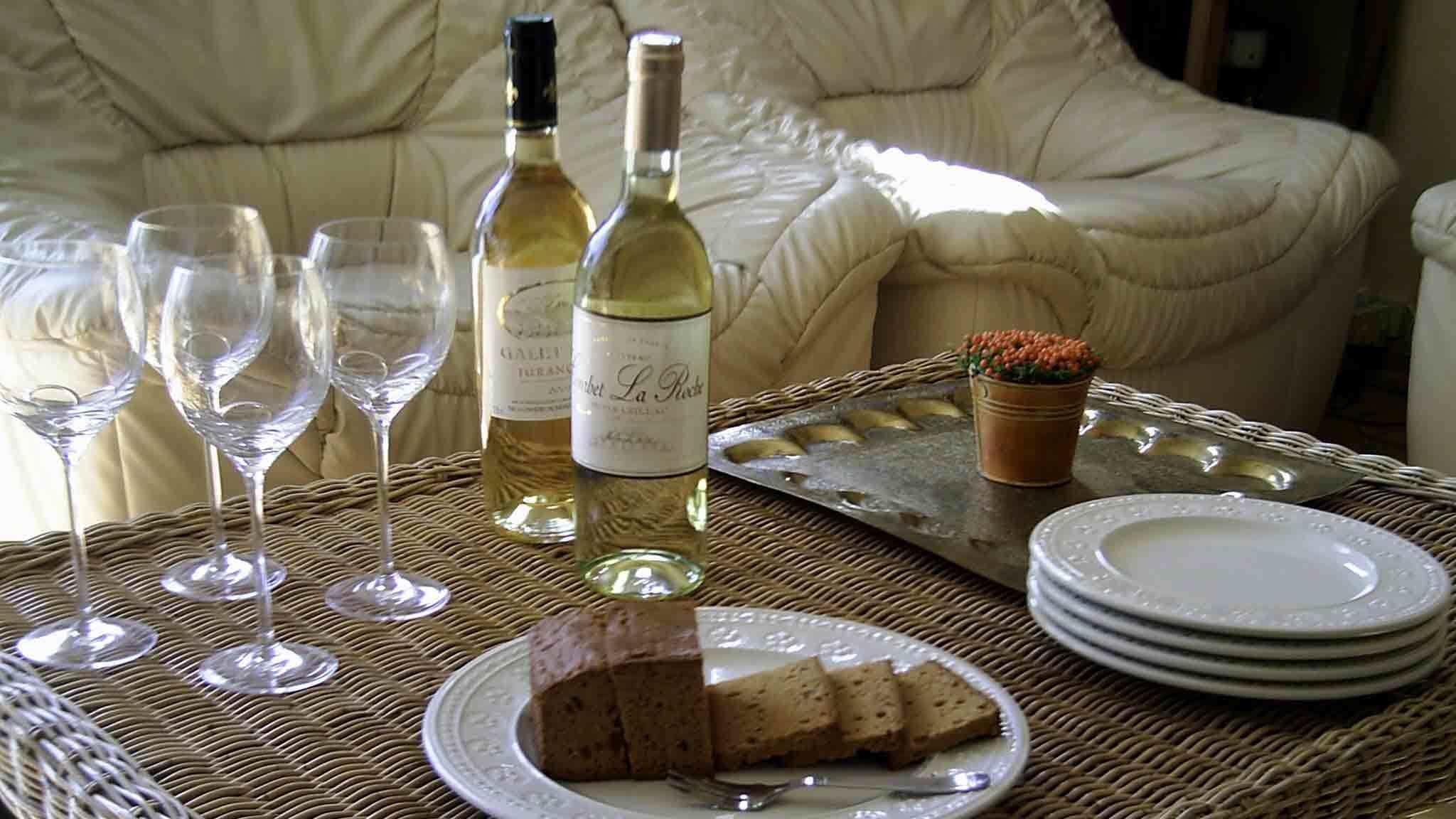 Wine and bread on a coffee table in Paris