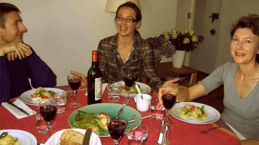 Group enjoying a home-cooked meal in Paris