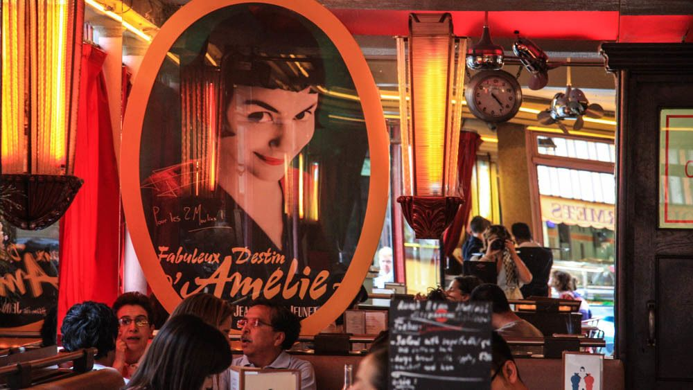 Interior shot of French cafe with Amelie poster in view.