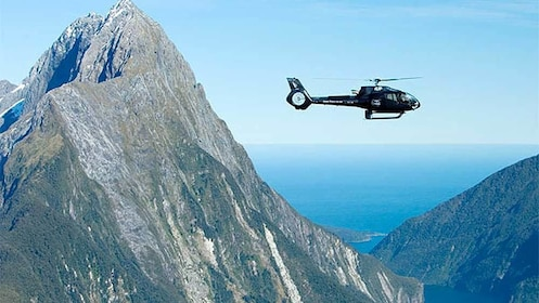Serene day view of a helicopter tour over the Milford Sound and Glaciers in New Zealand