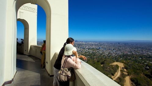 People looking at the view from the Griffith Observatory in Los Angeles