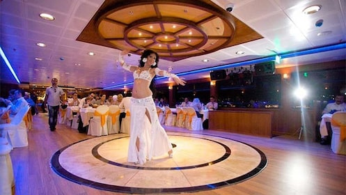 Woman performing a dance aboard the New Year's Eve Dinner Cruise on Bosphorus in Turkey