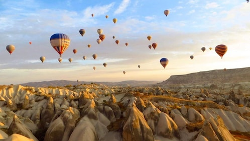Many hot air balloons floating above Turkey