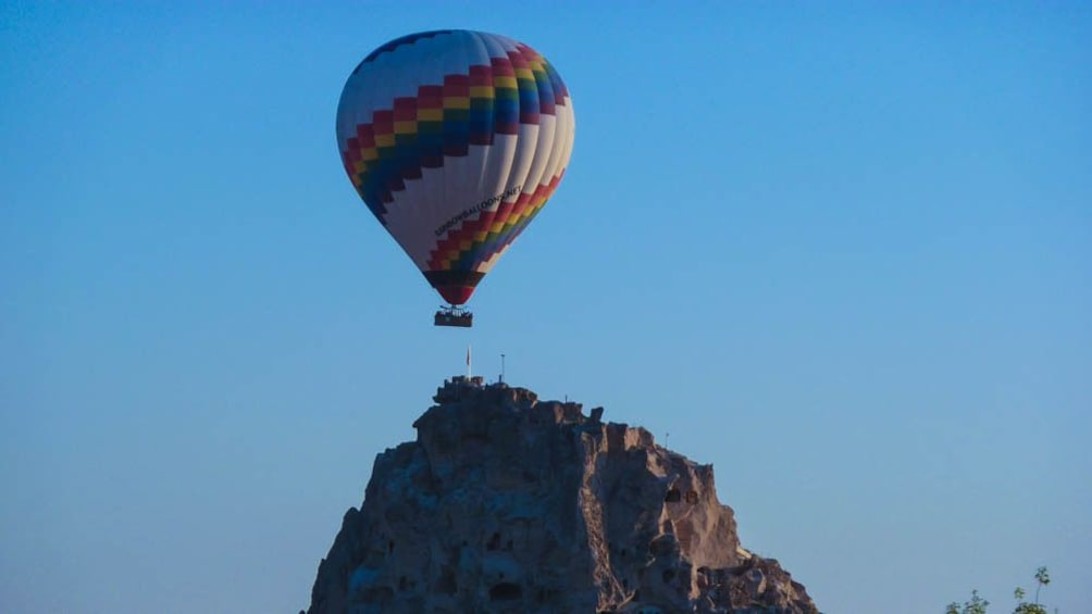 Show item 5 of 5. Hot air balloon ascending over canyon.