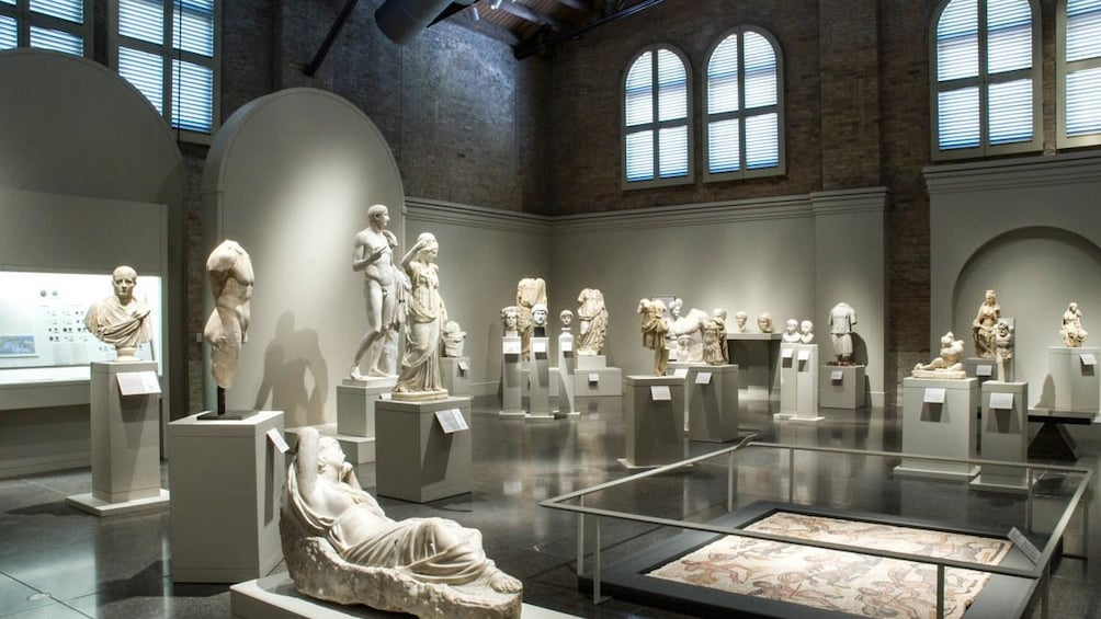 Interior view of museum featuring several sculptures.