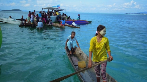 People on small boats in Sabah