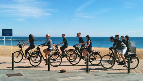 a group of bike riders at the beach in Barcelona