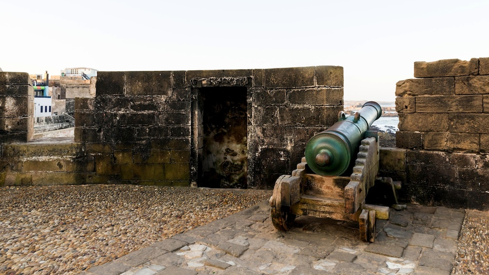 The battlements of a Moroccan castle with an old cannon