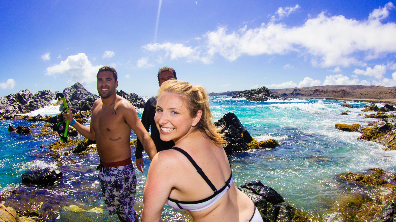 Group enjoying a swim on the Island Ultimate Safari in Aruba