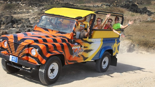 A tour jeep with people waving
