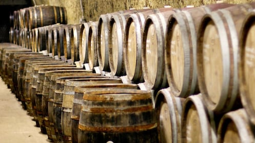 stacked barrels inside a cellar in Budapest