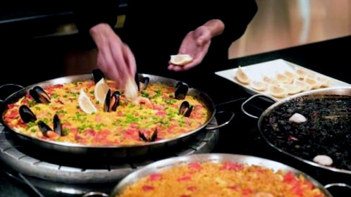 Food being prepared during a Paella and Tortilla Cooking class