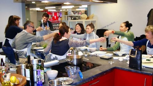 A Paella and Tortilla and Sangria Cooking class in Madrid toasting with Sangria