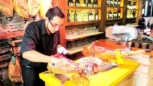 man slicing thin ham in Madrid