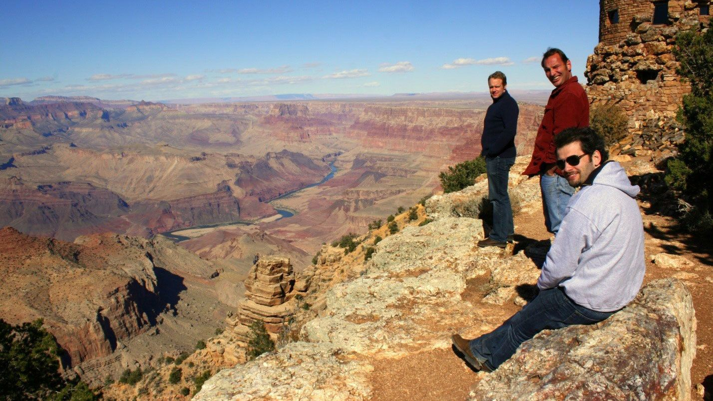 Group of men on the edge of the Grand Canyon