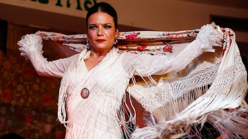 woman in intricate outfit dancing the flamenco in Madrid