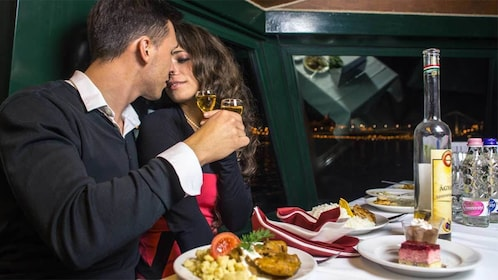 Couple enjoying their time together on the dinner cruise in Budapest