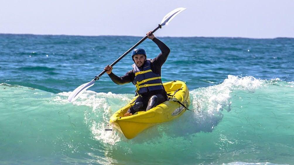 Show item 2 of 5. man kayaking through the ocean waves in San Diego
