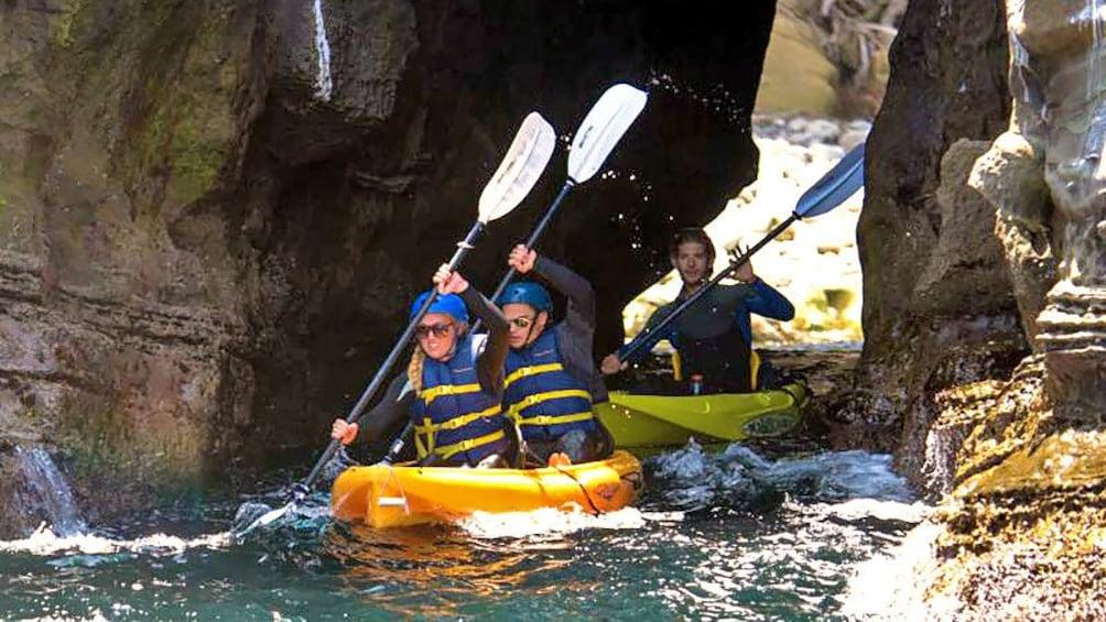 Show item 1 of 5. kayaking through a narrow gap in San Diego