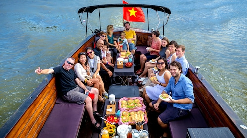 Patrons pose for the camera on the Saigon Breakfast tour