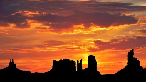 A silhouetted monument park at Sunset