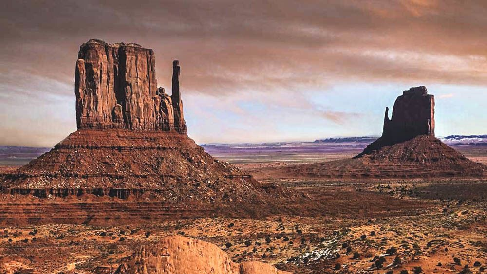 Landscape view of Monument Valley at dusk.