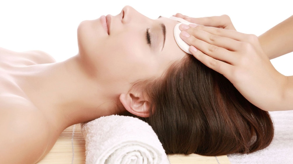 woman receiving a forehead massage at the spa in Seattle