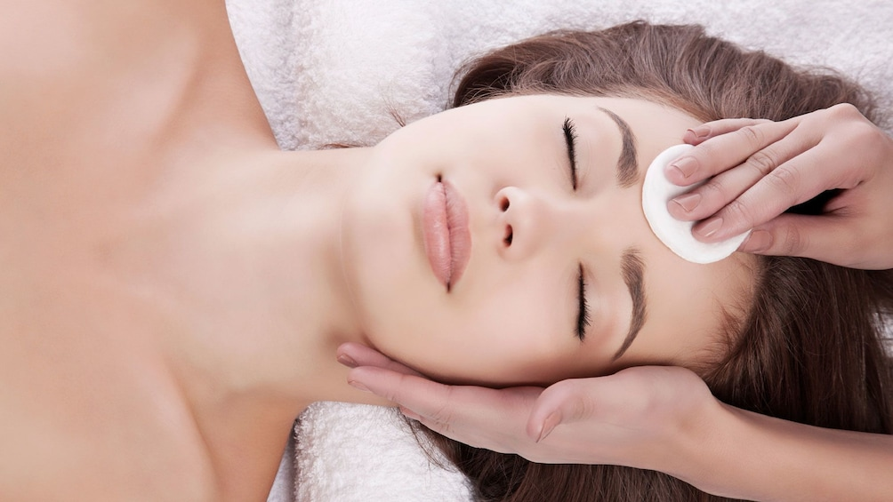 woman receiving a spa facial in Seattle