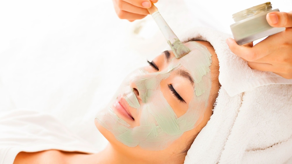 applying spa products to a woman's face in Seattle