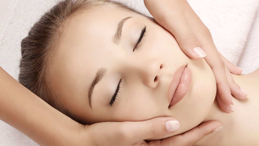 woman getting a face massage at the spa in Seattle