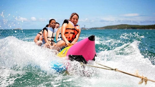 group riding on a pulled inflatable raft in Bali
