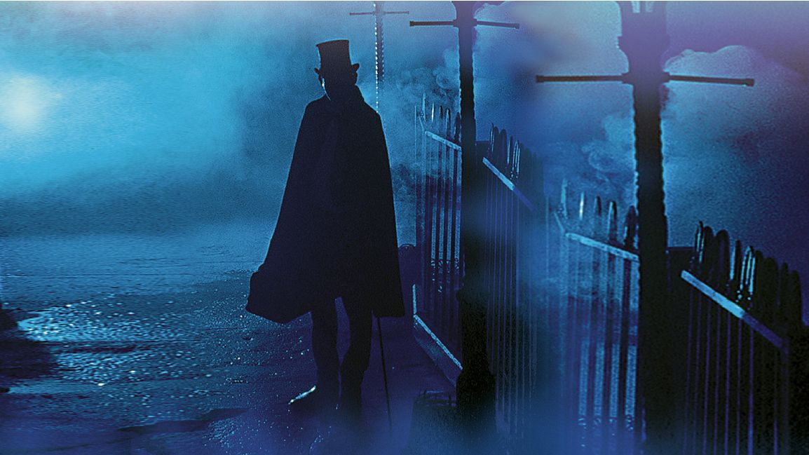 Image of Jack the Ripper on a London street at night cloaked in darkness and fog
