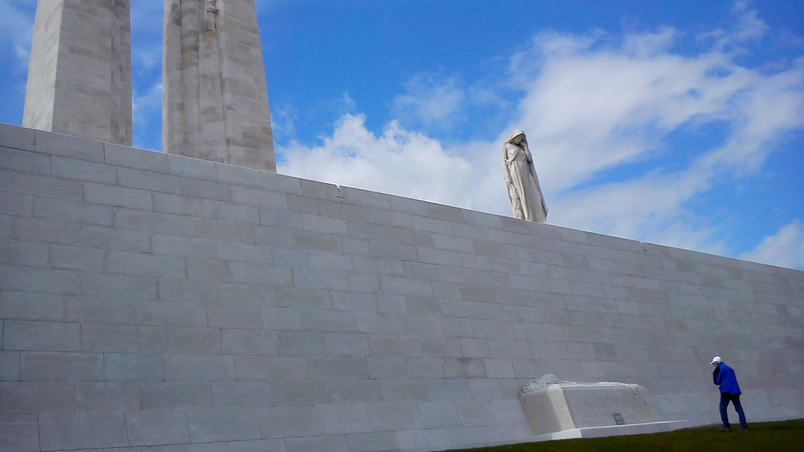 Large stone wall memorial and statues in Belgium