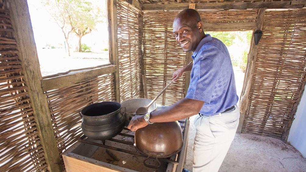 man preparing a meal at a stove at the Cayman Islands