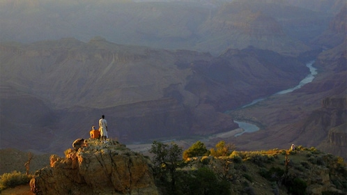 Tourists at the Grand Canyon at sunset