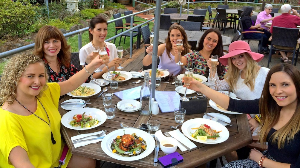 Show item 2 of 5. Group of ladies enjoying wine and food at a winery in Brisbane