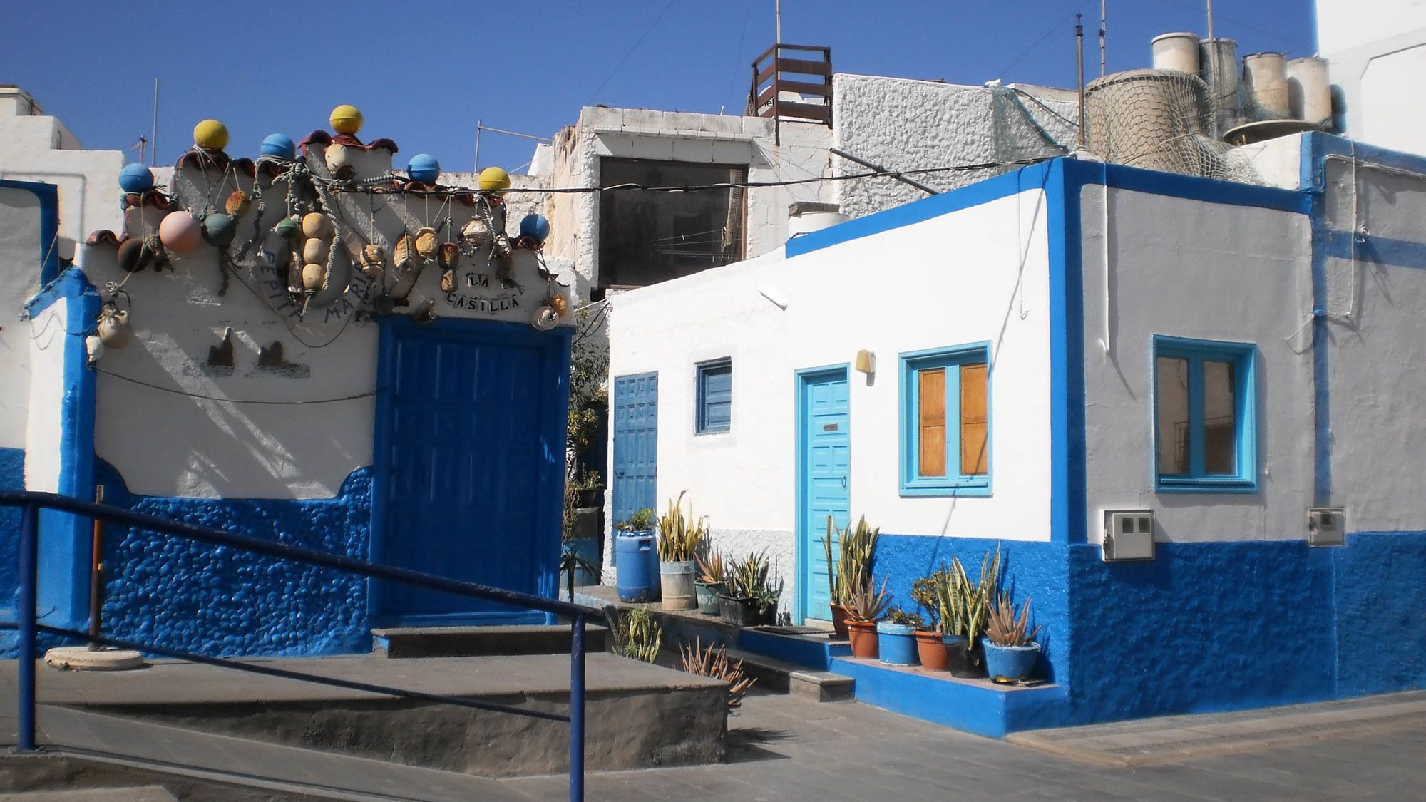a white and blue building in Gran Canaria