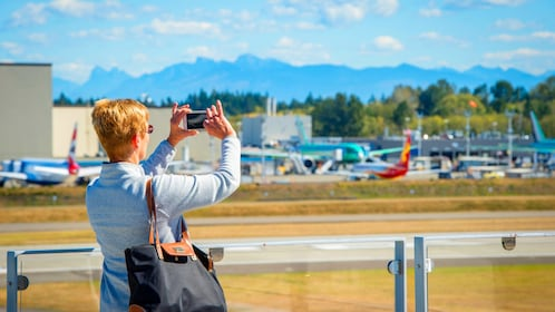 Woman takes a picture at Boeing field