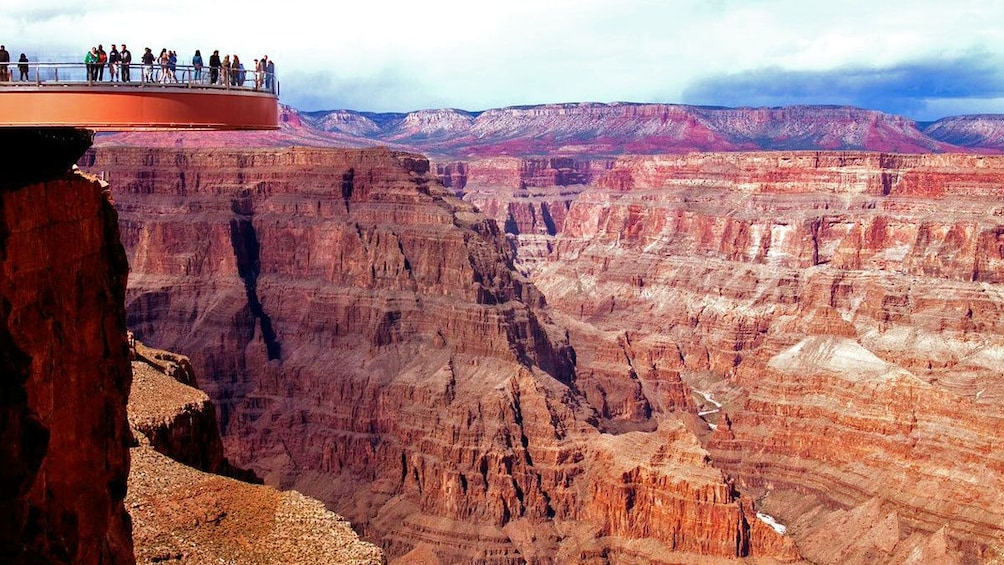 Show item 1 of 10. visitors standing on the Grand Canyon Skywalk
