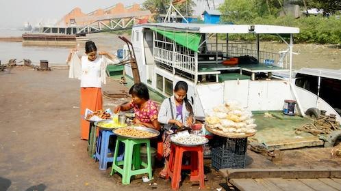 Locals preparing food in Myanmar